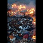 Houses swept out to sea burn following a tsunami and earthquake in Natori